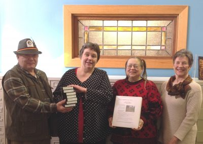 Mt. Hope Cemetery microfilm is presented to the library