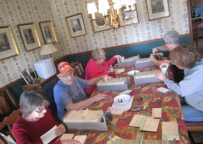 Volunteers organize Mt. Hope cards prior to microfilming